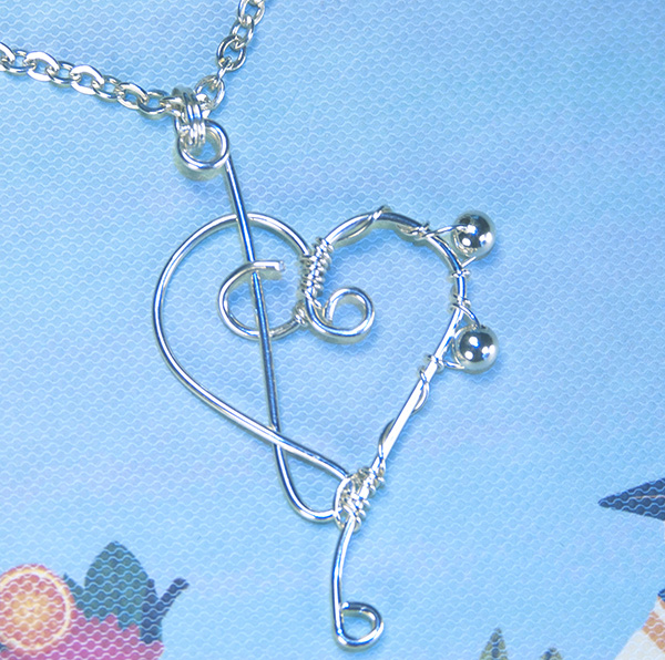 musical clefs heart necklace